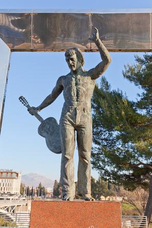 bard: PODGORICA, MONTENEGRO - JANUARY 23, 2016: Monument (circa 2004) to famous Russian singer and poet Vladimir Semyonovich Vysotsky in Podgorica, Montenegro. Sculptor Alexander Taratynov