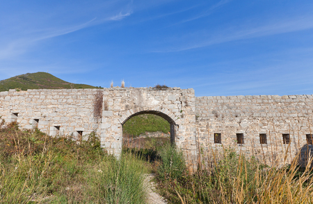 hardly: Ruins of Mogren Fort on Mogren Cape near Budva town, Montenegro. Erected in 1860 by Austro-Hungarians, hardly damaged in earthquake of 1979