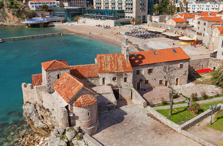 anointed: BUDVA, MONTENEGRO - MARCH 09, 2016: Church of Santa Maria in Punta (circa 840) and Church of St Sava the Anointed (circa 12th c.) in Old Town of Budva, Montenegro. View from the Citadel
