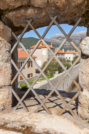 mentioned: BUDVA, MONTENEGRO - MARCH 09, 2016: View of Old Town through the window of Citadel (Castel St Mary) in Budva, Montenegro. The fortress was mentioned for the first time in ancient chronicles in 1425
