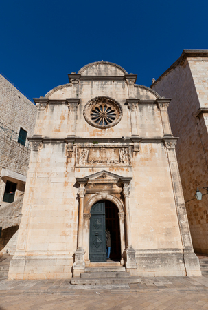 ecclesiastical: DUBROVNIK, CROATIA - JANUARY 20, 2016: Facade of Saint Saviour Church (Crkva sv. Spasa, circa 1520) in Dubrovnik, Croatia. World Heritage site of UNESCO Editorial