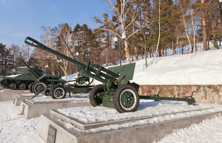 cannon gun: YUZHNO-SAKHALINSK, RUSSIA - MARCH 17, 2016: Soviet 76-mm divisional gun M1942 (ZiS-3) in Glory Square Memorial in Yuzhno-Sakhalinsk, Russia. The most used by Red Army cannon of WWII