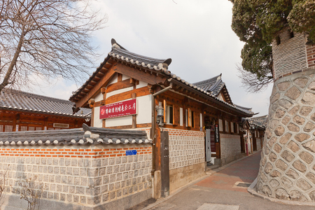 a traditional korean: SEOUL, SOUTH KOREA - MARCH 14, 2016: Han Sang Soo Embroidery Workshop of Folk Bukchon Hanok Village in Seoul, Korea. Hanok is a traditional Korean house Editorial