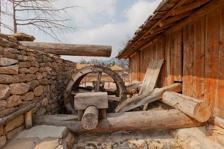 a traditional korean: SEOUL, SOUTH KOREA - MARCH 14, 2016: Replica of a traditional Korean Water Mill in National Folk Museum of Korea in Seoul