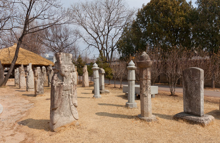 scholars: SEOUL, SOUTH KOREA - MARCH 14, 2016: Epitaph, statues of Scholars and Civil Officials in National Folk Museum of Korea in Seoul. Erected in 19th c