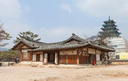 RELOCATED: SEOUL, SOUTH KOREA - MARCH 14, 2016: Traditional Korean hanok house (Ochondaek House, circa 1848) in National Folk Museum in Seoul, Korea. Relocated in 2010 from Gyeongsangbuk-do province