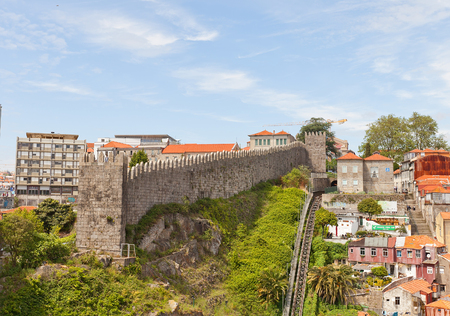 PORTO, PORTUGAL - MAY 25, 2016: City defensive rampart in Porto, Portugal (UNESCO site). Completed in 1370 in the reign of King Ferdinand I, so usually called as Ferdinand Walls (Muralha Fernandina)