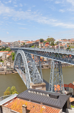 part of me: PORTO, PORTUGAL - MAY 25, 2016: Double-decked Dom Luis I Bridge over Douro River in the historical part of Porto city (UNESCO site), Portugal. Work of architect Teophile Seyrig, 1886