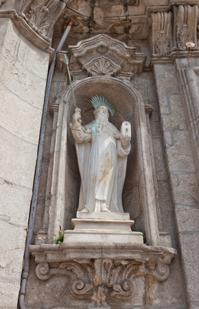 ecclesiastical: PORTO, PORTUGAL - MAY 26, 2016: Statue of Prophet Elias on facade of Carmo Church (18th c.)  in the historical center of Porto, Portugal.