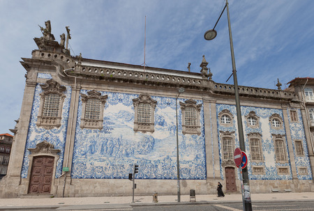 PORTO, PORTUGAL - MAY 26, 2016: Azulejo tiles on the side wall of Carmo Church (18th c.) in the historical center of Porto . Work of Silvestro Silvestri Editoriali