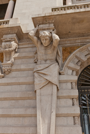 telamon: PORTO, PORTUGAL - MAY 26, 2016: Atlas sculpture on the facade of Municipality building (City Hall, early 20th c.) at Aliados Avenue in the center of Porto, Portugal. UNESCO site