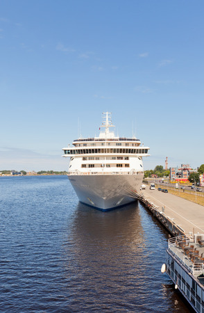 tonnage: RIGA, LATVIA - JUNE 7, 2016: 12 decks MS The World (IMO 9219331) in the port of Riga, Latvia. The World is the largest privately owned residential yacht (165 apartments, gross tonnage 43,524 tons)