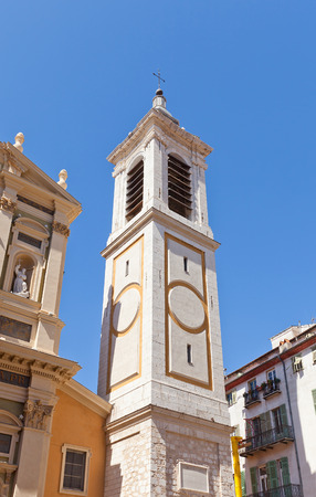 classed: NICE, FRANCE - APRIL 11, 2016: Belfry of Cathedral of Saint Reparata (circa 1699) in Nice, France. Architect Jean-Andre Guibert. Has been classed as a monument historique since 1906 Editorial