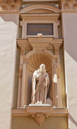 ecclesiastical: NICE, FRANCE - APRIL 11, 2016: Statue of St Bassus on the facade of Cathedral of Saint Reparata (circa 1699) in Nice, France. St Bassus was a Christian martyr and the first bishop of Lucera in Italy Editorial