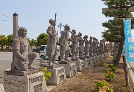 vendetta: AKO, JAPAN - JULY 18, 2016: Statues of famous 47 ronin in the Oishi Shrine. Shrine is dedicated to 47 loyal samurai (described in Chusingura tale) and is located on the grounds of Ako Castle, Japan Editorial