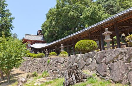 shinto: OKAYAMA, JAPAN - JULY 20, 2016: The 400 meter long covered walkway at Kibitsu Shinto Shrine in Okayama Prefecture. Kibitsu Shrine was the chief Shinto shrine (ichinomiya) of Bitchu Province Editorial