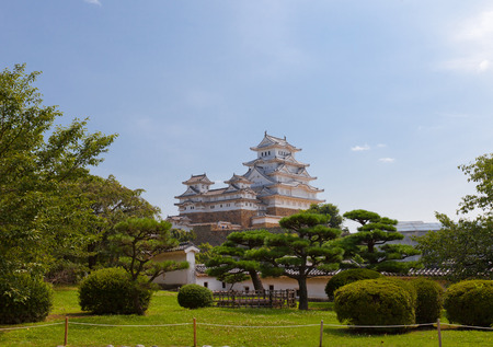 HIMEJI, JAPAN - JULY 21, 2016: View of main keep (tenshukaku) and small donjons of Himeji castle (White Egret Castle, 1609) from West Bailey.