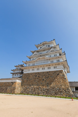 HIMEJI, JAPAN - JULY 21, 2016: Main keep (tenshukaku) of Himeji castle (White Egret Castle, circa 1609) after repairing works ended 2015.  National Treasure of Japan and UNESCO World Heritage Site