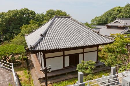 hondo: MATSUYAMA, JAPAN - JULY 22, 2016: Main Hall (Hondo, circa 13th c.) of Taihoji Temple in Matsuyama, Ehime Prefecture. National Treasure of Japan