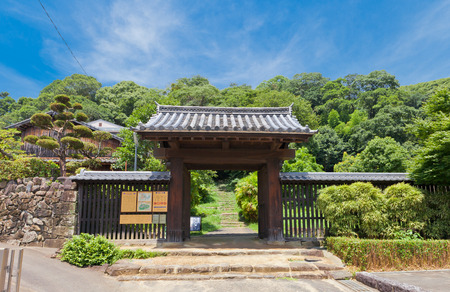 UWAJIMA, JAPAN - JULY 22, 2016: Noboritachimon Gate (circa 16th c.) of Uwajima castle, Shikoku Island, Japan. The oldest extant yakuimon style gate in Japan