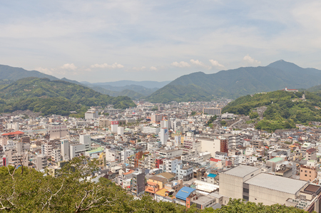UWAJIMA, JAPAN - JULY 22, 2016: View of Uwajima town from main keep of Uwajima castle, Shikoku Island, Japan. Uwajima has developed as center city in southwest of Ehime since early 17th c