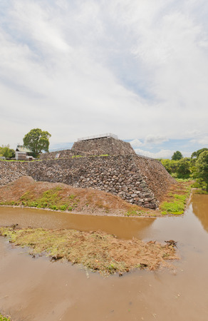 YAMATO KORIYAMA, JAPAN - JULY 23, 2016: Foundation of the main keep of Yamato Koriyama castle, Nara Prefecture, Japan. Castle was erected in 1580, abandoned in 1873 and partly reconstructed in 1980s