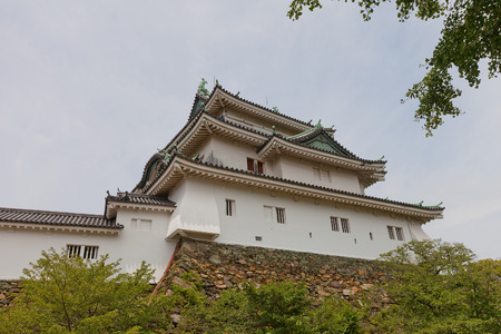 WAKAYAMA, JAPAN - JULY 24, 2016: Main keep of Wakayama castle, Japan. Erected in 1585, burned down in 1945, reconstructed in 1958