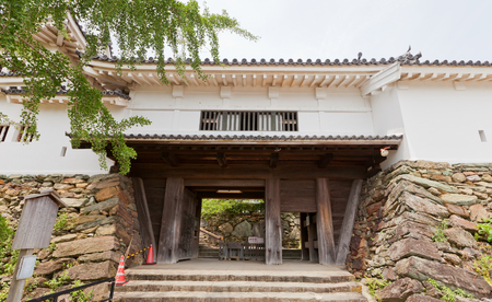WAKAYAMA, JAPAN - JULY 24, 2016: Ninomon (or Kusunoki) Gate of Wakayama castle, Japan. Castle was erected in 1585, bombed out in 1945, reconstructed in 1958