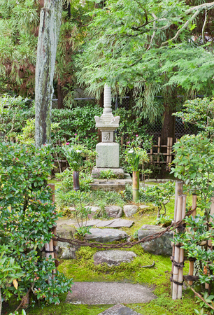 UJI, JAPAN - JULY 27, 2016: Grave of samurai Minamoto Yorimasa on grounds of Byodo-in Temple in Uji city near Kyoto. Yorimasa (1106-1180) committed suicide at Byodo-in after defeat in Battle of Uji