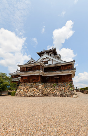 donjon: FUKUCHIYAMA, JAPAN - JULY 29, 2016: Reconstructed main keep (donjon) of Fukuchiyama castle. Castle was erected in 1579 by Akechi Mitsuhide, abandoned in 19th c., reconstructed in 1985