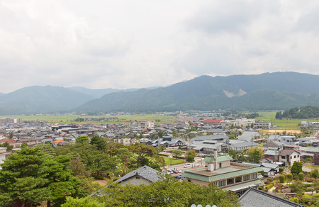 donjon: SAKAI, JAPAN - AUGUST 03, 2016: View of former Maruoka town from donjon of Maruoka castle. Modern city of Sakai was established in 2006 absorbing towns of Harue, Maruoka and Mikuni