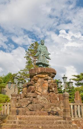 legendary: KANAZAWA, JAPAN - AUGUST 03, 2016: Statue of Prince Yamato Takeru (Meijikinen Monument) in Kenrokuen Garden of Kanazawa, Japan. Takeru (72-114) was legendary prince of Yamato dynasty deified in Shinto