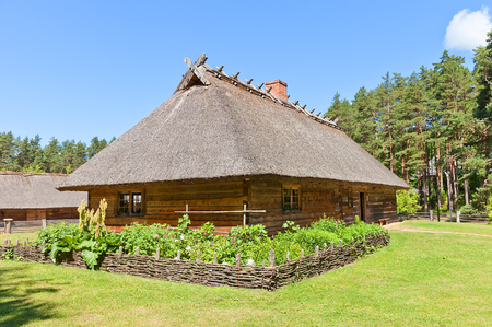 ethnographic: RIGA, LATVIA - JUNE 13, 2016: Dwelling rural house (circa 1848) of Veskerves farmstead of Kurzeme ethnic group. Exhibited in Ethnographic Open-Air Museum of Latvia since 2001 Editorial