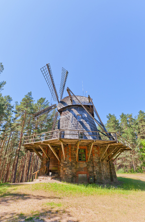 RIGA, LATVIA - JUNE 13, 2016: Dutch type windmill (circa 1890) of Pakalni village of Russian ethnic group. Exhibited in Ethnographic Open-Air Museum of Latvia since 1974 Editorial
