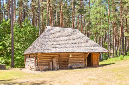 RIGA, LATVIA - JUNE 13, 2016: Stable (circa 19th c.) of Madari spinning wheelmaker homestead of Vidzeme ethnic group. Exhibited in Ethnographic Open-Air Museum of Latvia since 1975