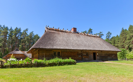RIGA, LATVIA - JUNE 13, 2016: Living rural house (circa 1848) of Veskerves farmstead of Kurzeme ethnic group. Exhibited in Ethnographic Open-Air Museum of Latvia since 2001