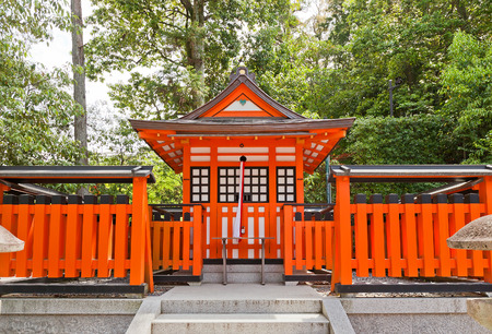 KYOTO, JAPAN - MAY 17, 2017: Offering hall (Kumotsusho, circa 19th c.) in Fushimi Inari Taisha Shinto Shrine in Kyoto. Shrine was founded in 711 and is famous for red torii gate corridors