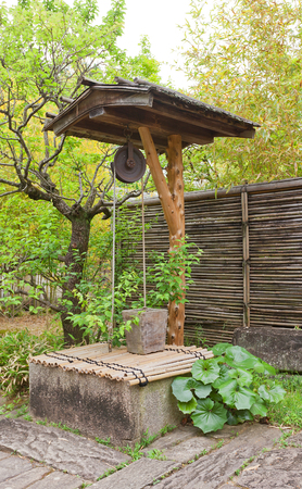 well laid: HIMEJI, JAPAN - MAY 16, 2017: Traditional well in Kokoen Garden near Himeji castle, Japan. Garden was laid out in 1992 to commemorate 100 anniversary of Himeji city