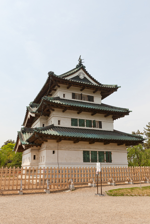 HIROSAKI, JAPAN - MAY 23, 2017: Main keep (donjon) of Hirosaki Castle. Was erected by Tsugaru Nobuhira in 1611, reconstructed in 1810, Important Cultural Property of Japan Editorial