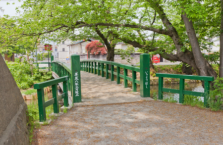 designated: HIROSAKI, JAPAN - MAY 23, 2017: Ichiyo-bashi Bridge of Hirosaki Castle, Japan. Castle was erected by Tsugaru Nobuhira in 1611, designated National Historic Site in 1952
