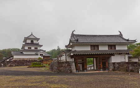 donjon: SHIROISHI, JAPAN - MAY 25, 2017: Reconstructed Main gate and Donjon (main keep) of Shiroishi Castle, Japan. Castle was founded in 1591 by Gamo Ujisato and dismantled in 1875 Editorial
