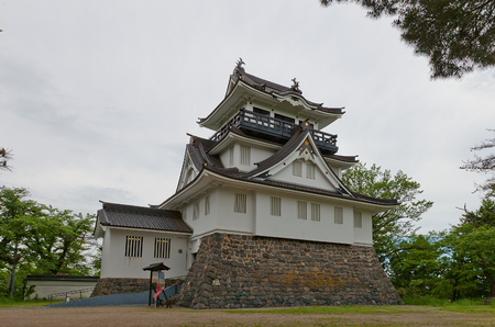 YOKOTE, JAPAN - MAY 26, 2017: Reconstructed Main Keep (donjon) of Yokote Castle, Japan. Castle was founded in 1550 by Onodera clan and burned down in 1868 during Boshin War