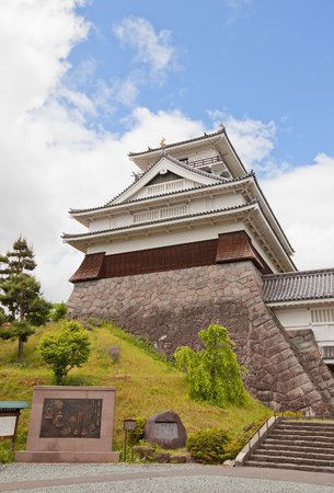 KAMINOYAMA, JAPAN - MAY 28, 2017: Main Keep (donjon) of Kaminoyama Castle, Japan. Castle was founded in 1535 by Takenaga Yoshitada, destroyed in 1692 and reconstructed in 1982