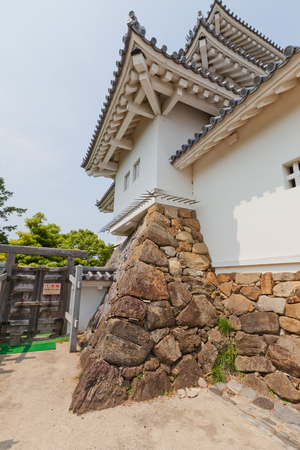 KAKEGAWA, JAPAN - MAY 29, 2017: Part of reconstructed Main Keep (donjon) of Kakegawa Castle, Japan. Castle was founded in 1497 by Asahina Yasuhiro, demolished in 1869 and reconstructed in 1993