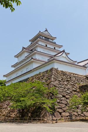 AIZUWAKAMATSU, JAPAN - MAY 30, 2017: Reconstructed Main Keep of Aizu-Wakamatsu Castle (Tsuruga-jo), Japan. Castle was founded in 1384 by Ashina Naomori, demolished in 1874 and reconstructed in 1965 Editorial