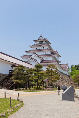 AIZUWAKAMATSU, JAPAN - MAY 30, 2017: Reconstructed Donjon of Aizu-Wakamatsu Castle (Tsuruga-jo), Japan. Castle was founded in 1384 by Ashina Naomori, demolished in 1874 and reconstructed in 1965