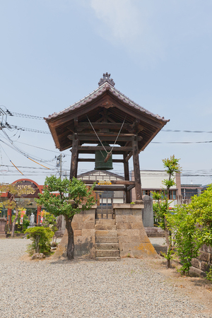 AIZUWAKAMATSU, JAPAN - MAY 30, 2017: Bell Tower of Amida-ji Buddhist Temple in Aizuwakamatsu, Fukushima Prefecture, Japan. Many victims of Boshin War (1868-1869) were buried in Amida-ji Temple