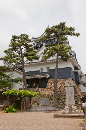 OKAZAKI JAPAN - MAY 31, 2017: Reconstructed Main Keep (donjon, circa 1959) of Okazaki Castle, Japan. Castle was founded in 1455 by Saigo Tsugiyori, shogun Tokugawa Ieyasu was born here in 1543 Editorial
