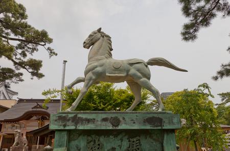 OKAZAKI JAPAN - MAY 31, 2017: Statue of a horse in Tatsuki Shinto Shrine of Okazaki Castle, Japan. Shrine is dedicated to deified shogun Tokugawa Ieyasu who was born in Okazaki castle Editorial