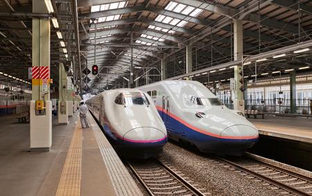 NIIGATA, JAPAN - JUNE 01, 2017: Double-decked E4 and E2 type high-speed trains on Niigata station, Japan. Operated by East Japan Railway Company (JR East) on Joetsu Shinkansen line